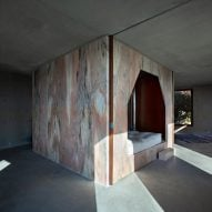 Pink marble core cuts through concrete interiors of Portuguese house