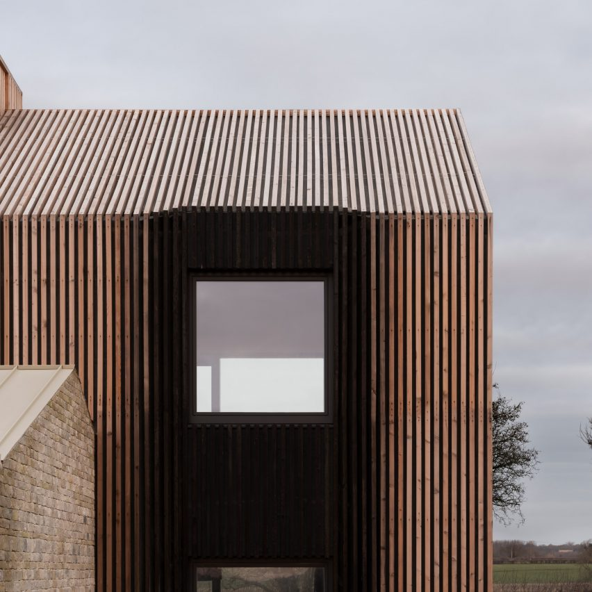 Bureau de Change covers barn-style Cotswolds house with ombré effect charred larch