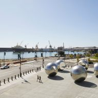 Olafur Eliasson's silver orbs create tunnel effect on San Francisco's waterfront