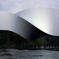 BIG bridges river in Norway with twisting art gallery
