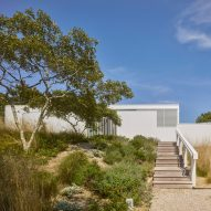 1100 Architect refurbishes 1970s cottage tucked into Long Island's sand dunes
