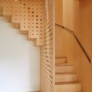 R2 Studio adds hole-punched staircase made of ash wood to London house