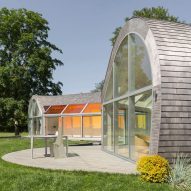 Skylights create rainbow patterns inside cedar-covered Cocoon House by Nina Edwards Anker