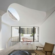 Two curved skylights flood sunlight into Oculi House by O' Neill Rose Architects