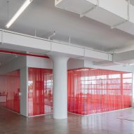 Red drapes partition stark white HUSH offices in Brooklyn