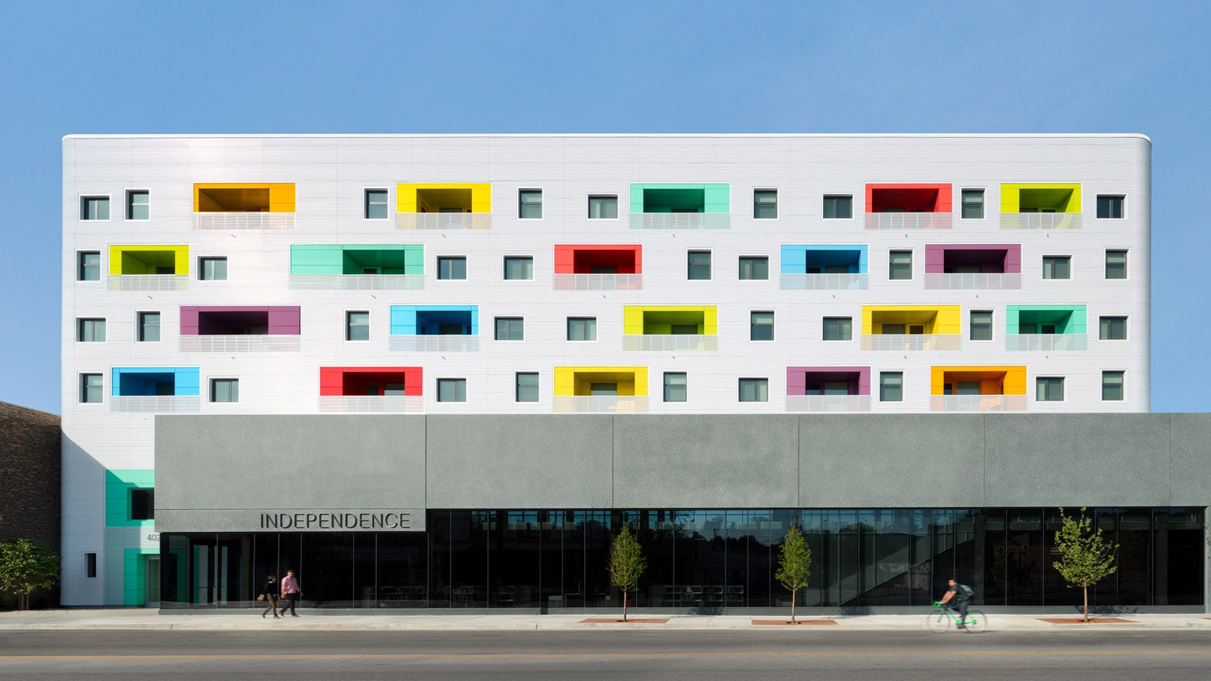 John Ronan creates affordable housing in Chicago with colourful balconies and a library