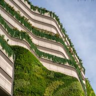 Green wall cascades down K11 Musea shopping centre in Hong Kong