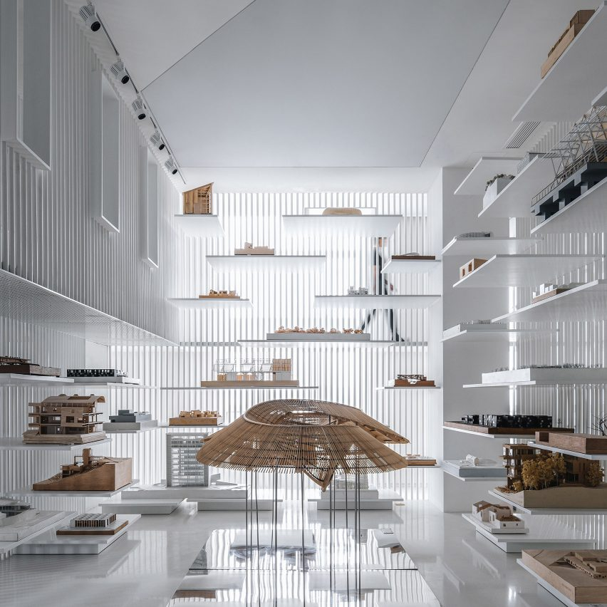 White steel and mirrored halls form sci-fi themed architectural model museum in China