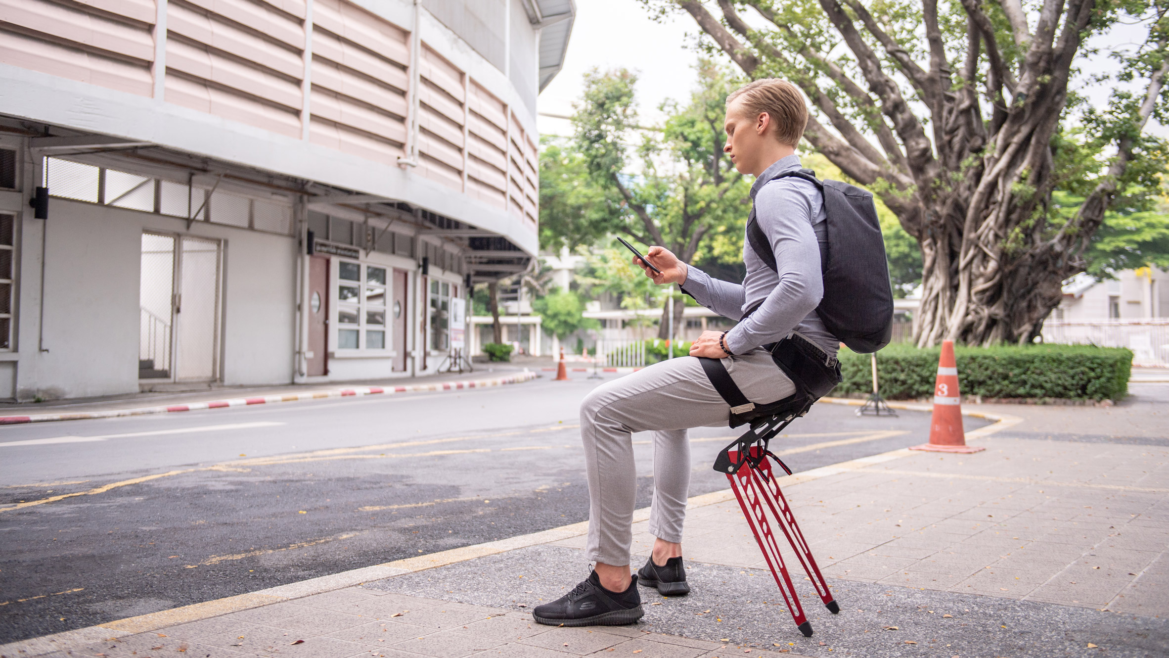 Lex by Astride is a wearable chair that allows its user to sit anywhere