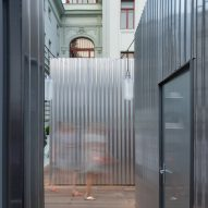 Chybik + Kristof builds Prague food market in shiny metal cabins