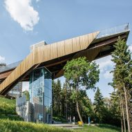 Dialog cantilevers wooden bridge over river valley in Edmonton