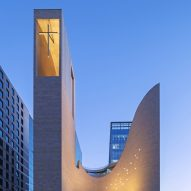 Observatory with suspended cross forms contemporary spire for South Korean church
