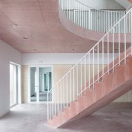 Pink concrete staircase connects colourful floors of Belgian school