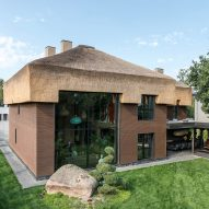 Sergey Makhno designs own thatch-roofed home filled with ceramics