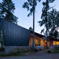 Angular black house by Campos Studio is designed around Canadian rainforest clearing