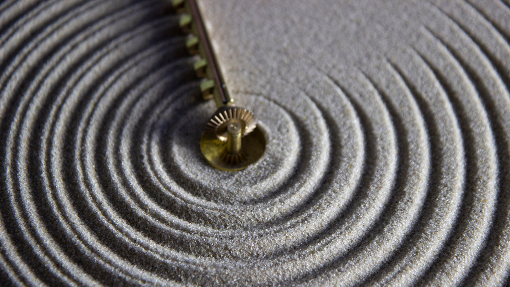 Studio Ayaskan Designs Clock That Rakes Sand To Show The Ripples Of Time