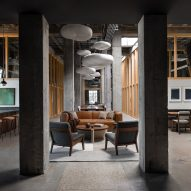 JHL Design converts abandoned Portland penthouse into moody office space for tech firm
