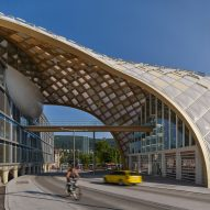 Shigeru Ban covers Swatch headquarters in vaulting timber shell