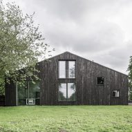 Tractor shed converted into house clad in scorched wood