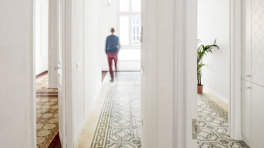 Decorative tiled floors reveal original room layout of renovated Barcelona apartments