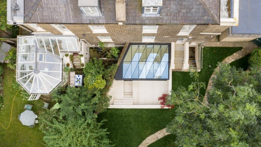 Faceted roof casts zigzagging shadows over London house extension