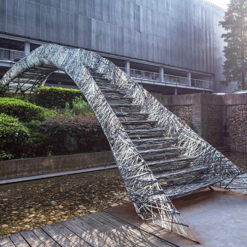 Two robotic fabrication methods entwine to make Tongji University bridge