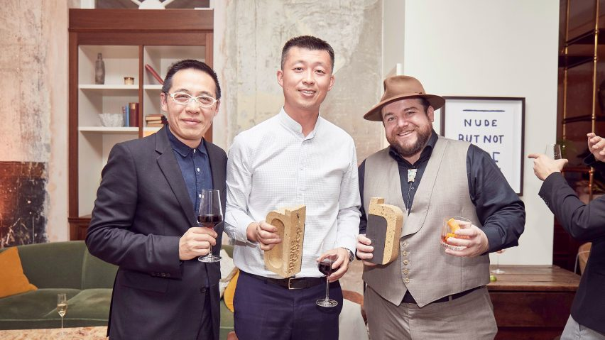 Yuyang Liu and Athony Tang of Atelier Liu Yuyang and Ryan Sarros of Vladimir Radutny Architects with their trophies for hospitality building of the year and apartment interior of the year