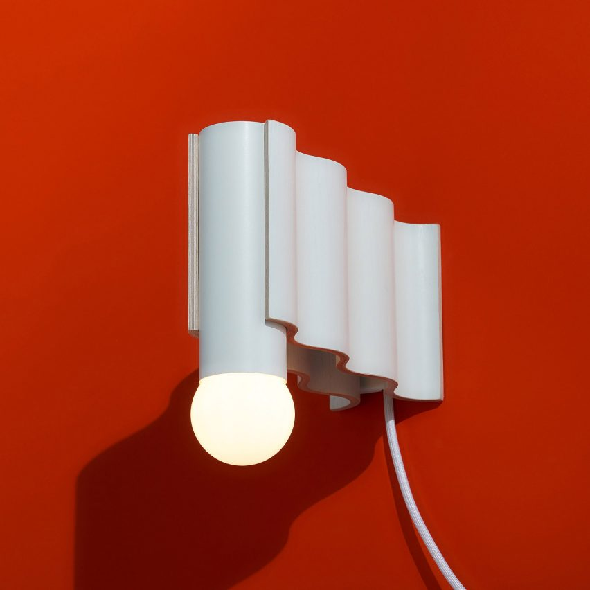 Corrugation Lights is a collection of wavy plywood lighting inspired by midcentury furniture