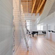 Metal grates form walls and railings inside Montreal apartment Aluminum Scarf