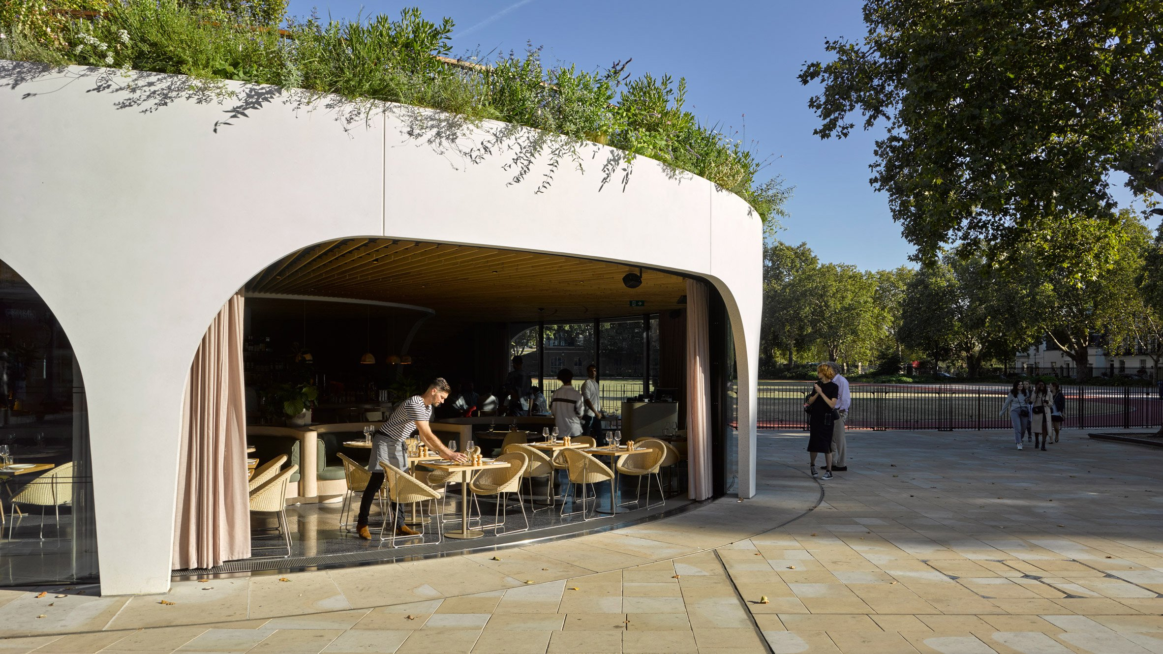 London cafe in spiral concrete shell has retractable windows