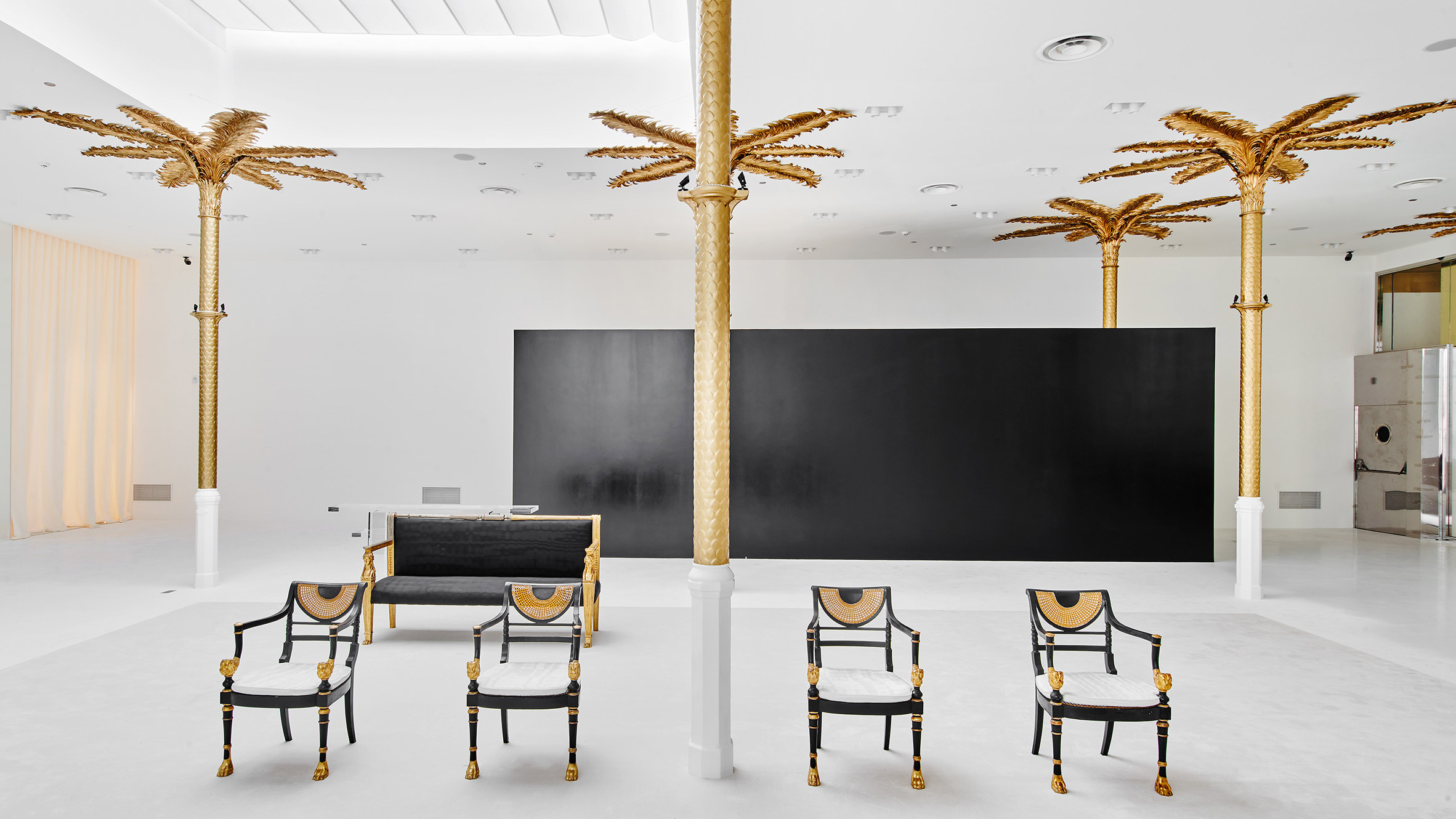 Gold palm trees adorn the monochromatic interior of Darial concept store in Barcelona