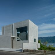 Hilltop concrete house frames views of the sea and a shrine in Japan