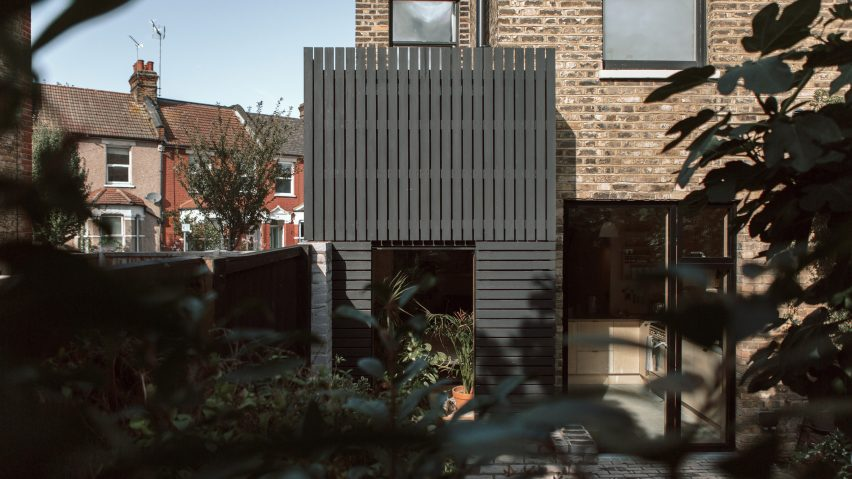 Black-painted larch planks clad extension to a house in London