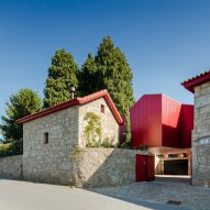 NOARQ renovates stone villa in Portugal with bright red details
