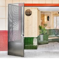 Palma Hideaway in Mallorca is obscured from the street by a tiny tiled garden