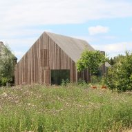 Cowshed in the Netherlands rebuilt as a timber-clad family home