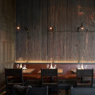 Dark oak and aged copper create cosy atmosphere in Samara bistro by Mutuus Studio