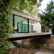 Bridge House by architect Dan Brunn straddles natural stream in Los Angeles