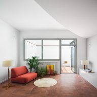 Hiha Studio breaks up linear apartment with curved corridor