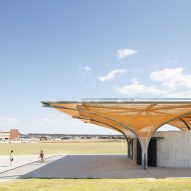 Golden mesh shades a sports pavilion in Sydney