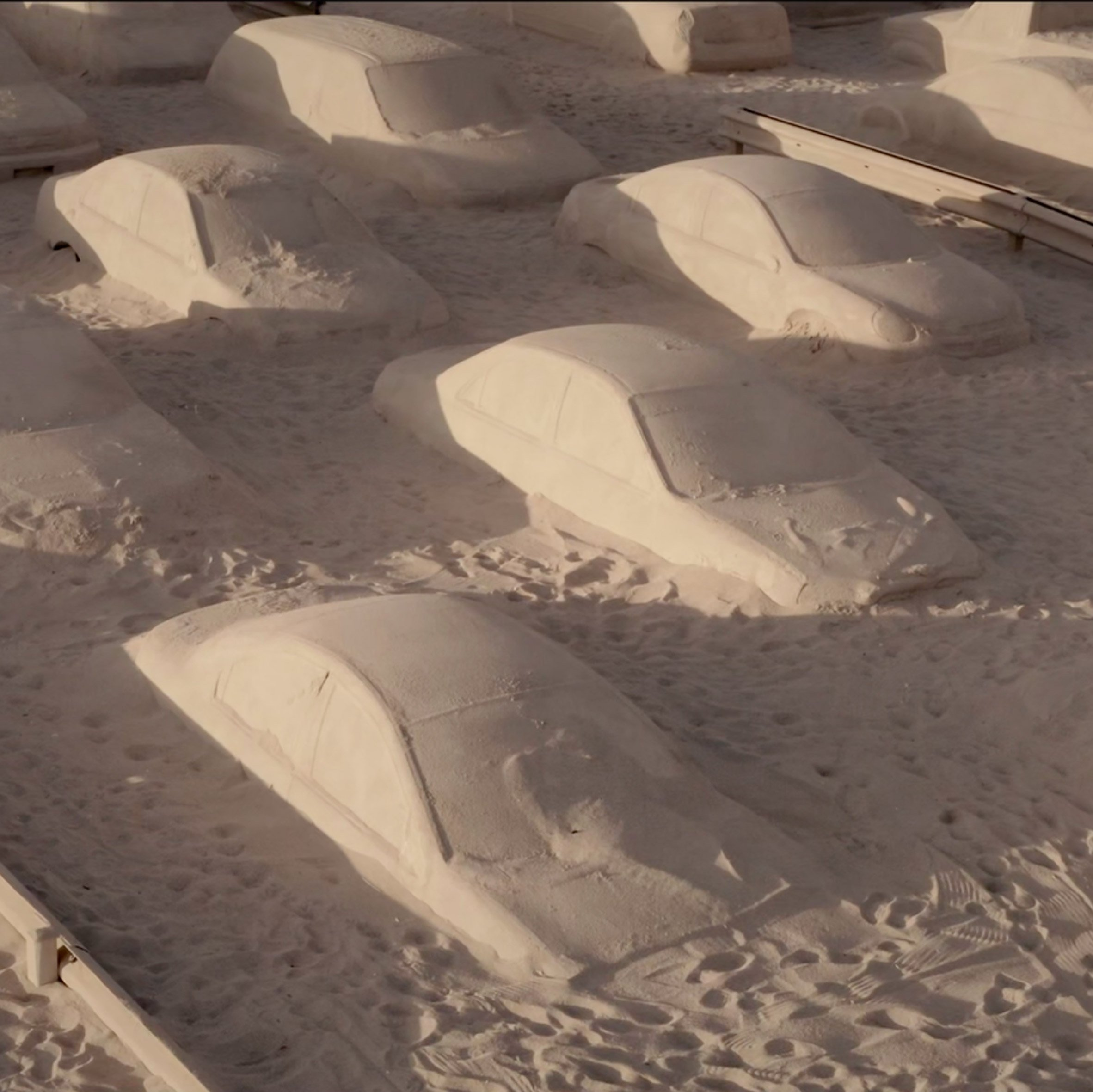 Artist Leandro Erlich creates sand-covered traffic jam on Miami beach