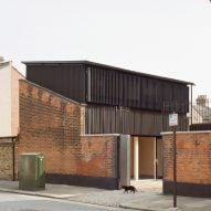 Russell Jones inserts small black home into Victorian outbuilding in London