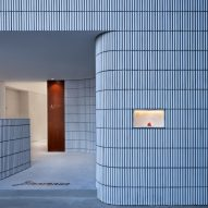 Curved tiled wall guides customers inside Hangzhou's Angelot patisserie