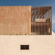 António Costa Lima inserts brick home into an old Lisbon warehouse