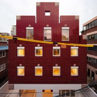 Blocky Minecraft-themed apartment building in Seoul clad with pixel-like tiles