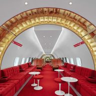 Stonehill Taylor designs retro Connie bar inside a plane at JFK's TWA Hotel