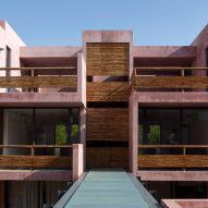 Pink Tulum residences surround central courtyard and pool