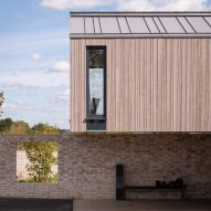 Weathered timber cladding covers shed-like house in rural England