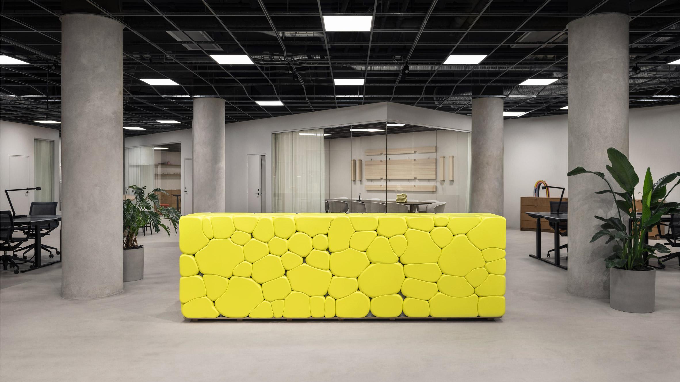Hem Headquarters Features Acid Yellow Concrete Desk