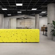 Yellow desk made from concrete-injected balloons features in Hem headquarters